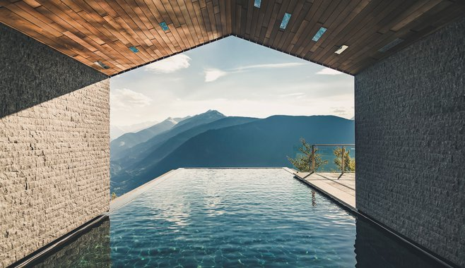 Miramonti Boutique Hotel - Infinity Pool in south tyrol  the pool is like a warm cave that leads you to the stunning scenery in all four seasons. Caressed by 32°C warming